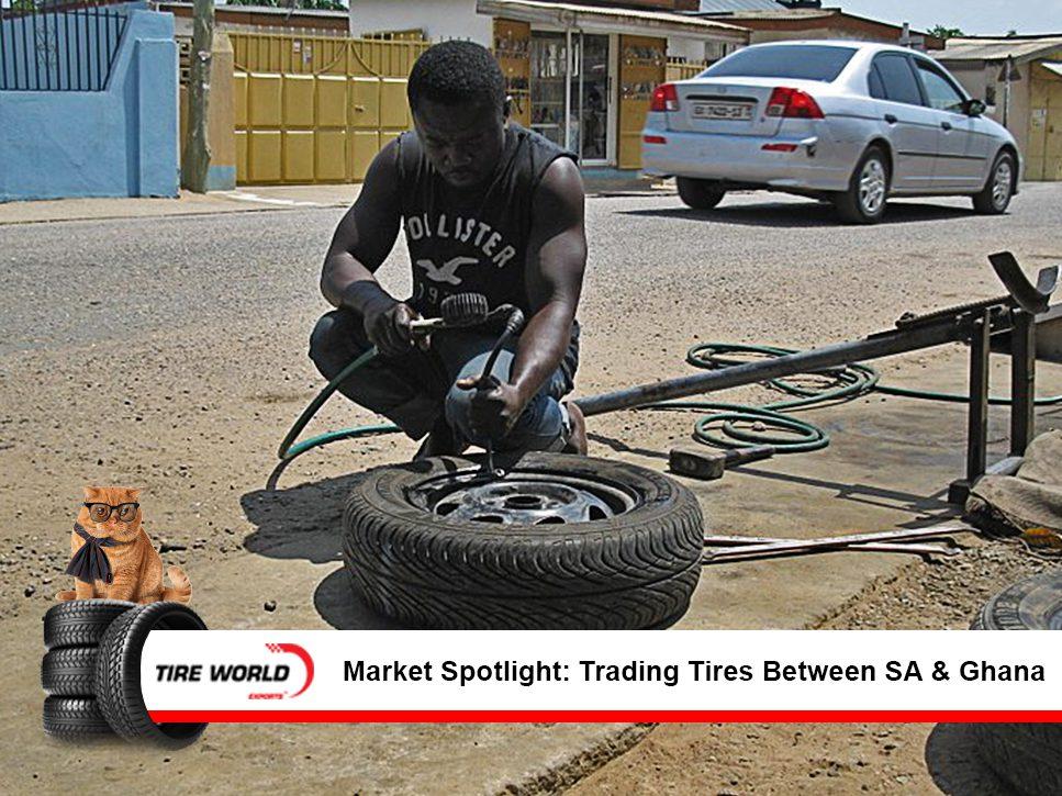 a Ghanian man repairing a tire