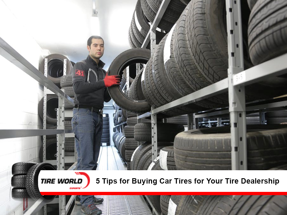 Man handling tires in a tire warehouse